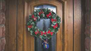 green and red christmas wreath on door